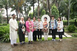 8 members from Japan took a picture in front of the memorial stone of the funder chairman Mrs. Kawamura